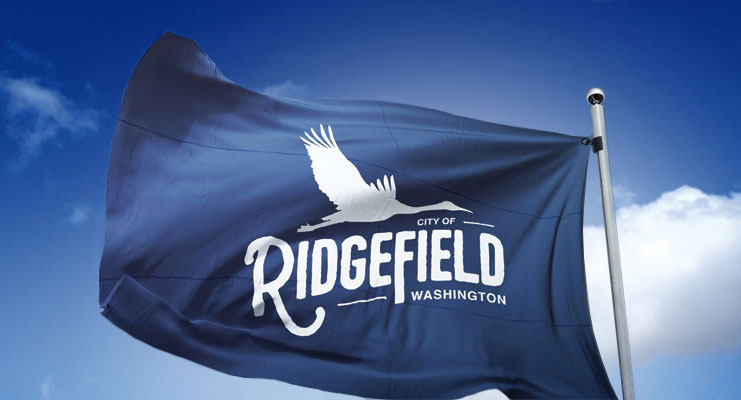 Blue flag with City of Ridgefield logo.